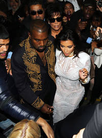Kim Kardashian tackled by weird Russian prankster guy at Paris Fashion ...